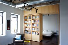 Vic Loft, Chicago, IL, United States by Moss / Sliding bookcase secret passageway to the bedroom