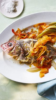 A whole red snapper is shallow fried and served with escovitch, a traditional Caribbean vegetable dish.