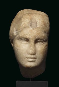 AN EGYPTIAN MARBLE HEAD OF A QUEEN