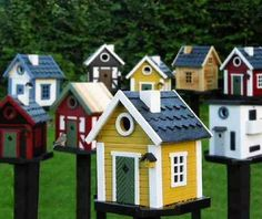 Swedish bird houses by Robert Nobel.  Would love to have a few of these....