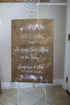 "Stained plywood custom painted wedding welcome with purple and blush floral detail. Couple names and wedding date.  ""Happily Ever After""."