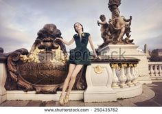 Beautiful woman on Pont Alexandre at dawn, in Paris, France.