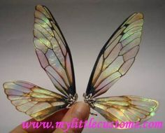 Wing Tutorials Fairy Wing Tutorials wings made out of something called Angelina Film that you can get at a hobby store.Fairy Wing Tutorials wings made out of something called Angelina Film that you can get at a hobby store. Polymer Clay Kunst, Polymer Clay Fairy, Dragonfly Wings, Beaded Dragonfly, Butterfly Wings, Fairy Crafts, Toy Art, Paperclay, Doll Tutorial