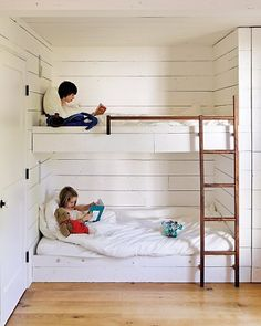 Bunk beds in a closet.