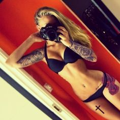 Like the placement of the flowers, and she has a great body..motivation as well.