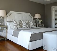 Grey and white master bedroom. Love. Nice base colors, then can change out small things like the centre throw pillow, lamp shade, etc w/ pops of color & switch them according to seasonal colors.