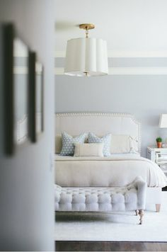 Master Bedroom. Soft blue palette. Bed ottoman, blue walls. With white bedspread??