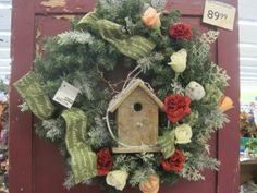 This Wreath from our Classic Rose Garden collection is made up of roses, green ribbon and white fern picks. The striking color pallet makes it a beautiful companion for the classic Christmas theme.