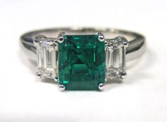 Clean and chic emerald cut emerald and baguette diamond ring, from Doyle & Doyle.