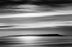 Portland. Dorset. England. The view of Portland taken from Ringstead Bay. I like the black and white version of this picture which works really well for me. The colours are gone making the image focus on the natural tones textures and patterns in the scene. #architecturalphotographer #buildingphotographer #commercialphotographer #constructionphotographer #constructionproductphotographer #industrialphotographer #interiorphotographer #landscapephotographer #professionalphotographer…