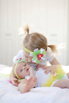 Big sister little sister matching outfits. Matching onesie,tutu skirts and hair bows. Pick your 2 sizes and message me.