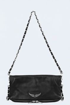 Zadig et Voltaire zipped clutch, two removable chains with different length, metallic wings on the front, width 26cm, height 15cm, depth 2cm, shoulder strap lenght 75 & 124cm, 100% cow leather