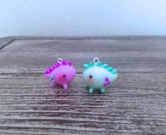 These chubby dinosaur charms are the perfect gift for a you and your best friend!  Made with love using polymer clay and paint. Each piece is