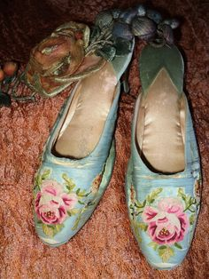 Gorgeous boudoir slippers dating from the teens to early 1920s. Aqua silk embroidered with bright pink and golden yellow Beauvais embroidery.