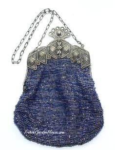 Fantastic 19th century Victorian Beaded Bag, with an ornate silver frame, chain and closure. Such a beauty, this late 1800's bag has the tiny Blue beads that sparkle and glow, but the real showstopper is the frame. Embossed, and quite ornate, it is further embellished with floral motifs. Round ball clasp and link chain, the inside is lined in leather with French floral ribbon trim.