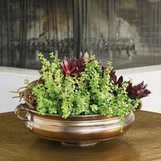 """Features: -Finish: Bronze. -Material: Ceramic. -Manufacturer provides 1 year warranty. Primary Material: -Ceramic. Dimensions: Overall Height - Top to Bottom: -7"""". Overall Width - Side to Side:"""
