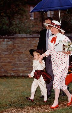 Prince Harry held the hand of Diana's sister Lady Sarah McCorquodale as they walked to the wedding of Viscount Althorp and Victoria Lockwood. The little Prince was dressed in a costume inspired by Eighteenth-century inspiredby a painting which hangs at Althorp. Photo: © Getty Images