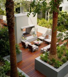 outdoor fireplace, hardwood floor, concrete planters