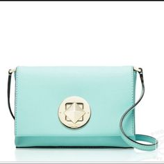 Kate spade new berry lane crossbody nwt Brand new beautiful light blue crossbody by Kate spade. Has adjustable strap and silver clasp. There is an inside compartment in the bag with pretty design. Color is a Robbins egg blue kate spade Bags Crossbody Bags