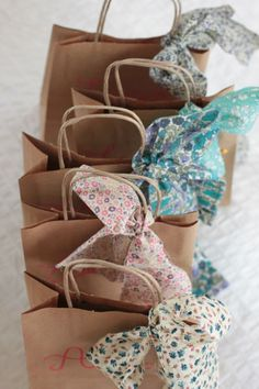 Use pretty fabric scraps to decorate gift bags.