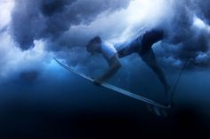 Surfer battling the underwater clouds, but if you make it to the otherside, rewards are big. Just like its often in life too.