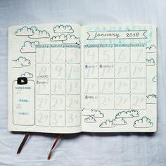 @bujo.by.marieke January monthly spread monthly overview cloud theme youtube tracker