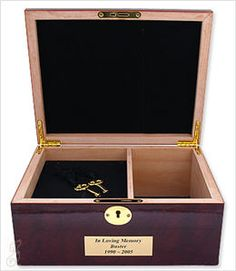 Memory Box holds treasured mementos of your best friend along with cremains for pets up to 50 lbs.   In addition to holding your pet's cremains, the Memory Box pet urn also provides a tray for photos, plus an open compartment designed to store your pet's collar, leash, toys or other remembrances.