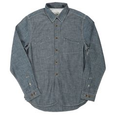 Scrub. Made of 100% Cotton Indigo Chambray imported from Japan Natural corozo button with lazered pattern Irregular chest pocket with functional stitching detail Tripl