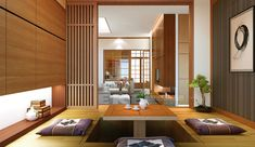Tuananh Eke's oriental sunken dining in wood with bonsai and view to bamboo and ricepaper doors