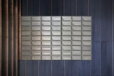 Multiple fire-rated mailboxes Bronze finish at London, Victoria Street proj. Mail Room, Fire Rated Doors, Lobby Design, Interior Concept, Lobbies, Affordable Housing, Model Homes, Modern House Design, Small Apartments
