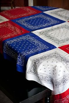What a great DIY idea - family tablecloth made with red, white, and blue bandanas! This would make a great beach or picnic blanket, too.