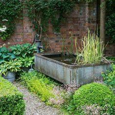 Water feature from repurposed vintage metal trough