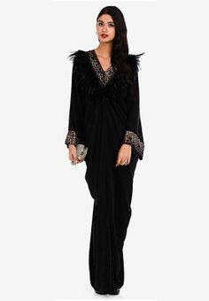 Flaunt your wild side in style with Lilly by Scabiosa. Built to offer a modest alternative blended with a voguish appeal, this Abaya features hot leopard print trims to the neckline and sleeve cuffs along with light crystal accents.