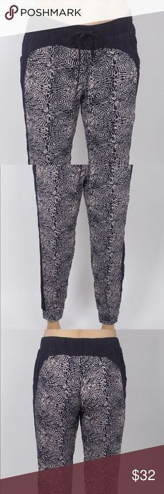 Fitted ankle harem pants Black + tribal print, light weight harem pants with a fitted ankle and draw string waist. These pants come straight from down unda, Sydney, Australia. They might be the comfiest pants on the planet & they have pockets! They're perfect for lounging around the house or hanging with friends. Pants Track Pants & Joggers