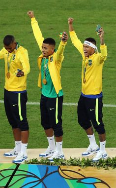 Neymar (R) of Brazil celebrates with his gold medal after the Men's Football Final between Brazil and Germany at the Maracana Stadium on Day 15 of the Rio 2016 Olympic Games on August 20, 2016 in Rio de Janeiro, Brazil.