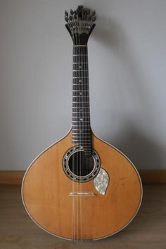 Guitarra Portuguesa (Portuguese Guitar) is a plucked string instrument with twelve steel strings, strung in six courses comprising two strings each. It is one of the few musical instruments to still use the so-called Preston tuners. It is most notably associated with fado- Wikipedia.
