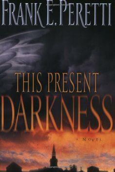 This Present Darkness: Frank E. Peretti: 9781581345285: Amazon.com: Books