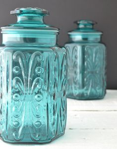Teal Glass Canisters - Vintage Kitchen Canisters - Atterbury Scroll - Imperial Glass - Aqua Glass Jar - Apothecary Jar - Set of 2. $60.00, via Etsy.