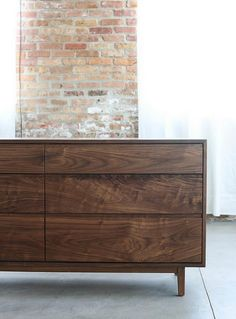 Our Hayward Dresser is handcrafted with interlocking miter joints, giving it a sleek but sturdy profile. Includes six drawers, grooved pulls, dovetailed drawers, and self-closing, smooth glide slides mounted under drawer boxes.  Pictured: WALNUT Also Available: Cherry, Maple, Red Oak, and White Oak  DIMENSIONS - 63W x 20D x 31H  Drawer Face Heights (Top to Bottom): -5 11/16H -7 11/16H -9 11/16H  Interior of Drawers (Top to Bottom): -27 5/8W x 16 13/16D x 4 3/16H -27 5/8W x 16 13/16D x 6…