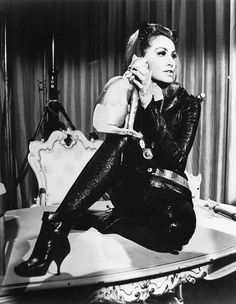 Julie Newmar as Catwoman. I so wanted to be her! We loved this show, never missed an episode. Then, in my teens, I watched it again, and got all the cultural and political satire attached.