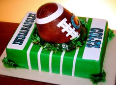 Indianapolis Colts - This is a strawberry/strawberry cream cheese cake iced with IMBC and covered with fondant.  The cake was airbrushed as well as hand-painted.  The football is a giant rice krispy covered in fondant.  Thanks for looking!