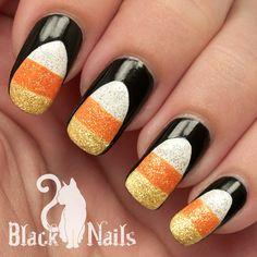 Glittery candy corn for Halloween! On the underside of this manicure is an extra pop-of-color surprise – orange outlined with black.