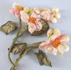 Vintage French ribbonwork roses blended with wax buds.