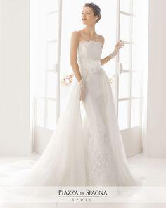 Modello MARION - Seguendo uno degli ultimi trend bridal, il brand spagnolo propone anche vestiti da sposa a maniche lunghe, trasparenti o completamente coprenti. E, per non rinunciare né a sensualità né a romanticismo, meritano sicuramente la tua attenzione i modelli a sirena di colore rosa, originali e raffinati.