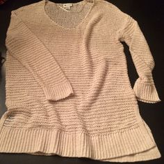 Cream Open Knit Sweater This is a must have spring/summer sweater!  Cream color light weight open knit with 3/4 length sleeves. V Neckline, knitted bottom band with side slits and knitted band details on sleeves. Truly the perfect sweater! Sweaters V-Necks