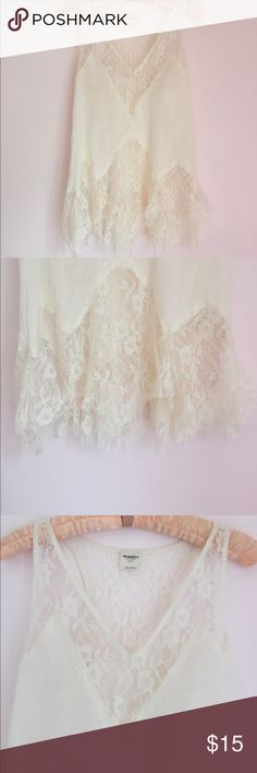 Intimates by FREE PEOPLE lace tank Cream colored, with lace. The. Breast area doesn't have any lace so you can wear a real bra with the tank . All the lace is in perfect condition Free People Tops Tank Tops