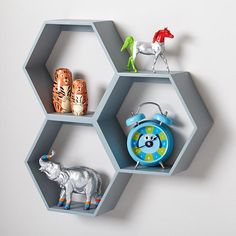 Modular Honeycomb Wall Shelves are a great way to display your kid's collections. Available in grey and white.