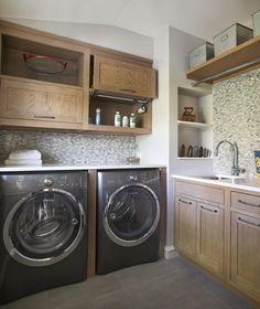 Designing a laundry room? Going classic with wood cabinets is a good start. To make the wood stand out, choose light colors for the walls and countertops like Pure White Caesarstone. To elevate the space, add industrial hardware. 4 Designer Laundry Rooms to Inspire - The Interior Collective