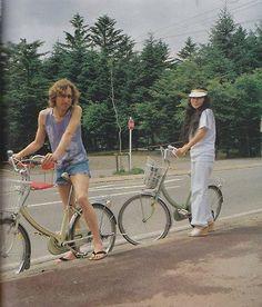John Lenon and Yoko Ono with their bicycles