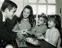 George Clooney, 7, looks at his dad